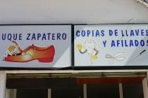 Schilder eines Schuhmachers und Schlüsseldiensts