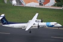Die Dash 8 Q400 hebt von der Runway ab