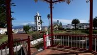 Der Torre de Relogio vom Jardim Florencio Terra fotografiert